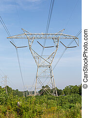 High Power Lines Under Blue Sky - High Power LInes in Midst...