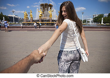 Follow me Young happy girl pulls the guys hand - Follow me...