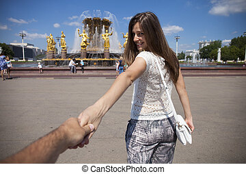 Follow me. Young happy girl pulls the guys hand - Follow me....