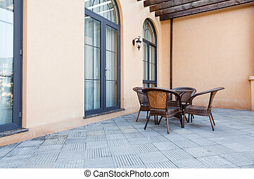 Patio with rattan chairs and table