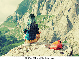 Female traveler in the mountains ???: Traveler young woman...