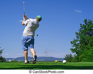 Golfer playing on golf course - Photo of a male golfer...