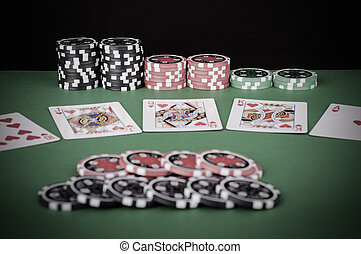 green casino table with royal flush, red and black chips - vintage