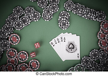 top view of green casino table with royal flush, red and...