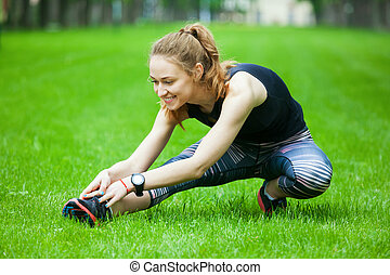 Shot of an attractive young woman stretching.