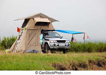 ZARUBINO, RUSSIA - JULY 22, 2015: SUV with rooftop tent on...