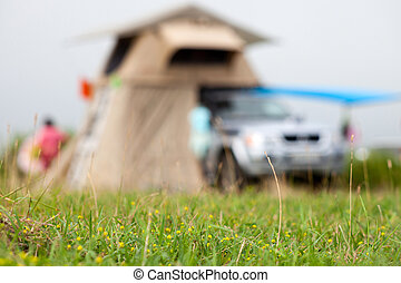 A car with rooftop tent defocused blurred