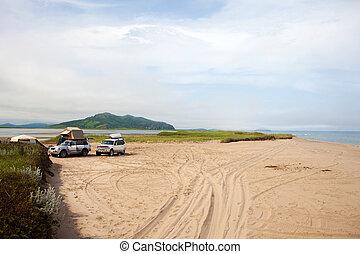 Automobile camp on sandy beach