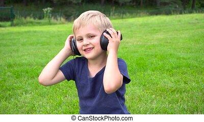boy listen music on tablet outdoors - cute boy listen music...