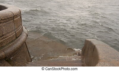 Waves hitting about quay - Storm on the Neva River in St...
