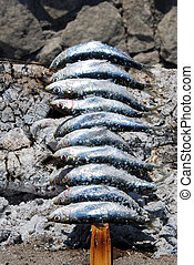 BBQ sardines on Fuengirola beach. - Sardines cooking in a...