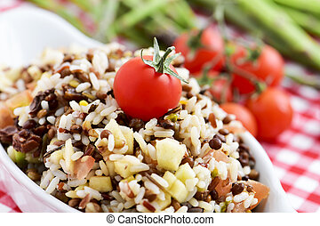 lentil and rice salad - closeup of a bowl with refreshing...