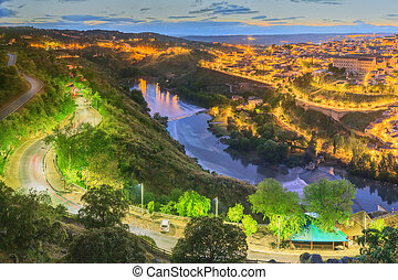 Toledo cityscape and Tagus River from hill, Spain - Night...