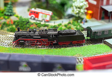 City in miniature. Model of train on railstation.