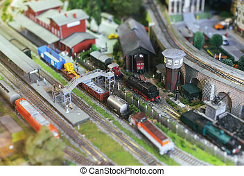 City in miniature. Model of train on rail station.