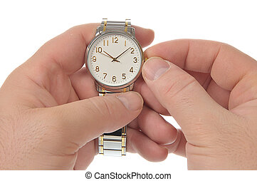 wristwatch - Right hand puts time on wristwatch left arm of...