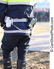 policeman in uniform with a radio transmitter and gun -...
