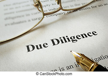 Due Diligence - Page of paper with words Due Diligence and...