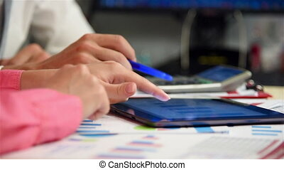 Browsing Financial News - Businesspeople Browsing Financial...