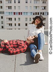 Everyone need a soulmate - Young man lying on a roof with...