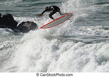 surfing wave - surfer riding a wave