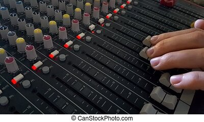 DJ Fingers control the sound on a mixer - DJ Fingers control...