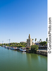 City of Seville with the Torre del Oro and Seville Tower -...