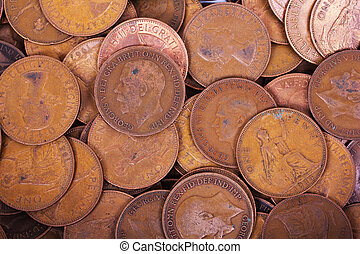 Old penny coins spread out for background - Old penny coins...