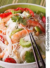 Thai salad yum woon sen macro on a plate. vertical - Thai...