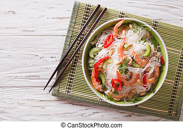 spicy Thai salad yam woon sen with seafood close up....