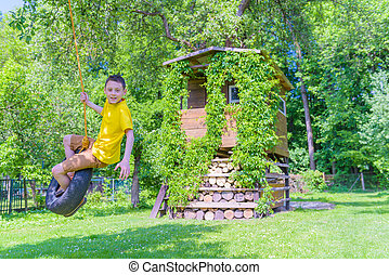 House - Smiling boy on treehouse Summer time