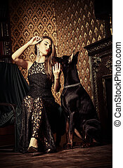 celebrity - Charming young woman with her dog in a room with...