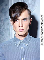 vogue hairstyle - Portrait of a young man with fashionable...