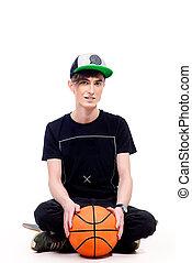 basketball - Modern young man with basketball and skateboard...