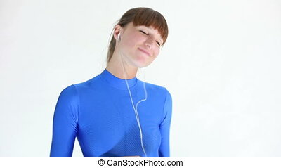 woman listening mp3 player - woman in blue leotard hearing...