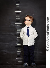 height meter - Four year old boy in white shirt and a tie...