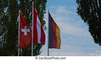 Three flag to flutter in the wind Austria, Germany,...