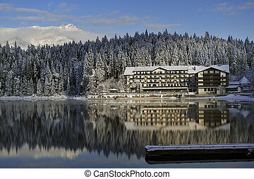 building reflection in mountain lake