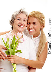 Mothers day - Portrait of pretty woman embracing her senior...