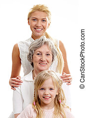 Women in line - Row of little girl, grandmother, mother...