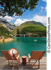 Two chairs and straw hat at lake Verdon - Travel to...