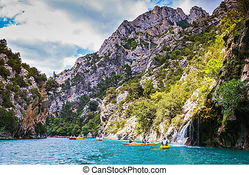 Colorful kayaks with tourists sailing on the river Verdon -...