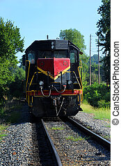Arkansas Railway - Red and black locomotive travels down...