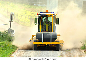 Dusty Job - Machinery works on fixing a dirt road in...