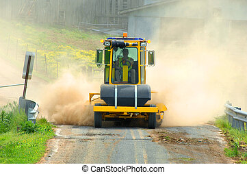 Billowing Dust - Respreading the gravel on a backroad in...