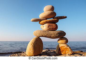 Inukshuk on seashore - Symbolic figurine of inukshuk of the...