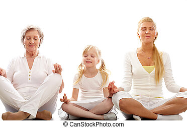Meditating - Row of grandmother, mother and child meditating...