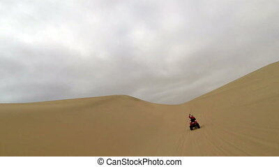 Quad biking through the sand dunes of Namib Desert, Namibia