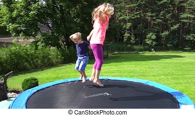 two kids jumping on trampoline slow motion