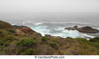 California ocean view hill and rocky shore